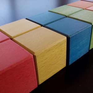 Montessori cubes are colored with water-based stain and varnished with water-based clear varnish