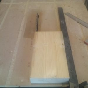 I used the table saw to bring the shelf to it's final width