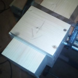 an improvised cutting jig helps cutting the large wooden beam