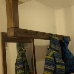 the very spacious wood beam hallway coat rack