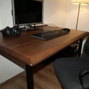 the chosen color of the desk was a walnut stain to match the black adjustable legs