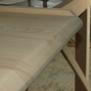 the sanded edges of the tabletop built for the office desk