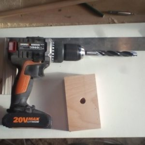 the freshly built jig and the drill bit used for the holes