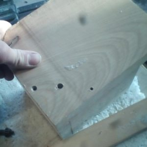 fixing the beech wood scrap on a square frame with screws