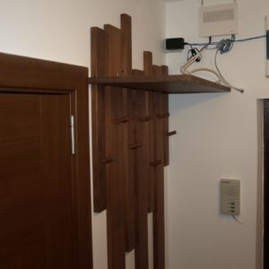the wall mounted wood coat rack made out of different sizes of planks