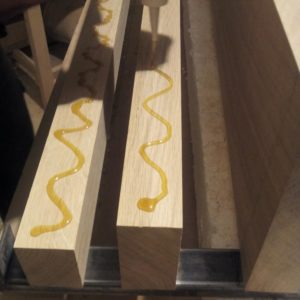 the application of the polyurethane adhesive on the edges of the oak wood planks