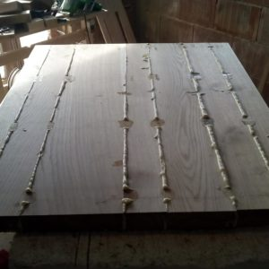 after the polyurethane adhesive was dry, the excess is removed and the oak wood table top is sanded