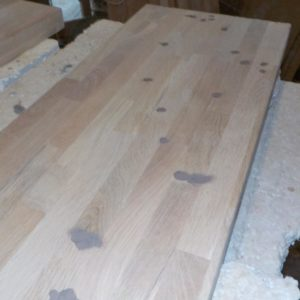 all the knots and the little imperfections of the finger joint oak wood panel were filled with wood putty