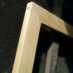 I reinforced the corners of the wooden frame using wooden dowels