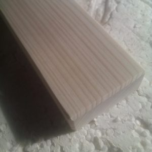a detail with the surface of a fir wood board