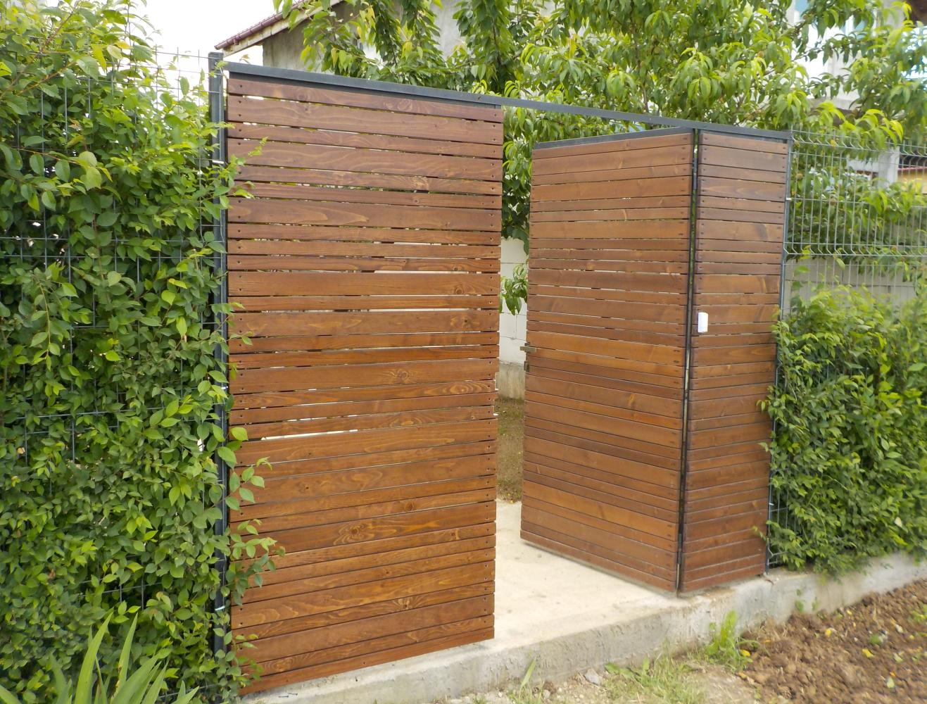the wooden gate built on steel tubing frame