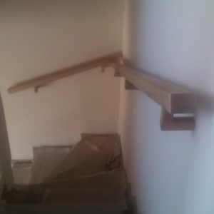 the railing handrail was mounted directly to the wall with these oak wood handrail wall brackets