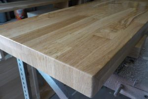 the oak wood panel appears to be thicker and looks much better