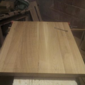 checking the oak wood planks before gluing the tabletop