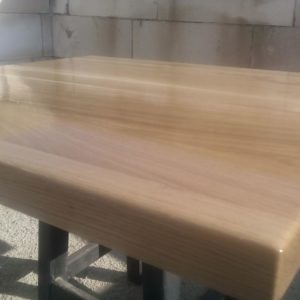 after the complete finishing of the solid oak wood tabletop, a protective polyurethane primer is applied