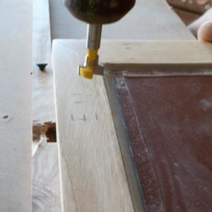 the T channel was routed in the frame using a stand drilling machine and a small parallel guide