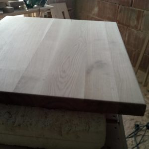 the thick solid oak wood table top was sanded on both sides