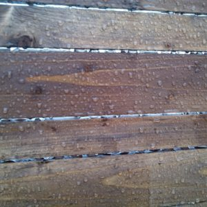 the rainwater gathers in droplets and does not penetrate into the wood