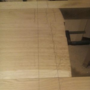 drawing the lines for cutting the oak wood panel