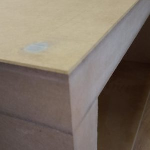 we sanded the sharp edges of the MDF cubes which will form the dividing shelf in the living room