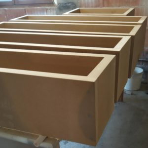 before applying the paint with hardener, we applied a special primer coat to close the pores of the MDF
