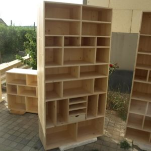 this design of storage furniture is a bookcase for organizing the books and it was made out of fir wood
