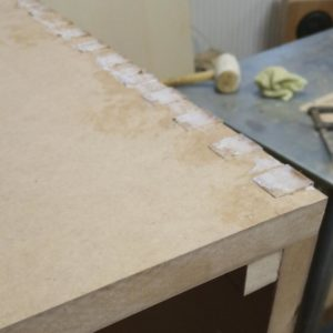 we glued the edges of the painted MDF bathroom furniture using box joint method and we will round them inside and outside