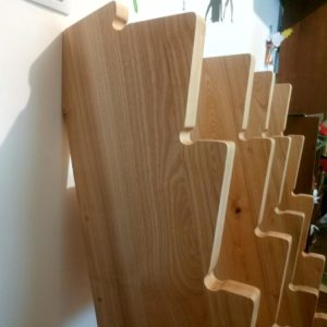 we built this stand out of ash wood for dumbbells to fit both in an apartment room and in a large fitness or gym room