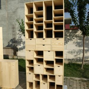 another design of wooden storage furniture with a lot of shelves and drawers which was made out of pine wood