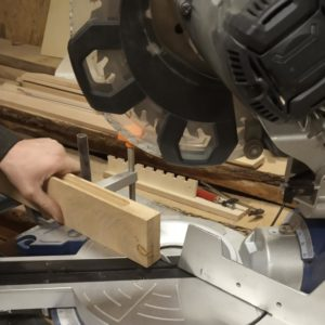 we cut the edges of the wooden light fixture modules with the circular saw to simplify the rounding operation