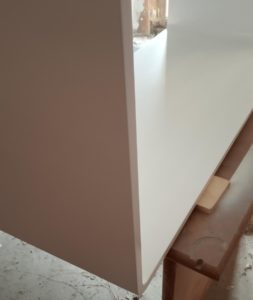 I painted with white paint the MDF bathroom vanity cabinet