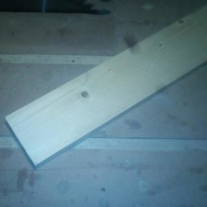 I used a fir wood plank to create the wooden jig for cutting the large beam