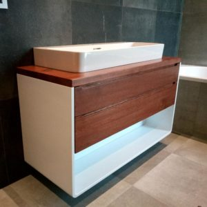 I used water-based stain, primer and anti-scratch polyurethane lacquer for the oak wood countertops and for the drawer fronts