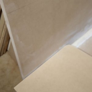 in order to be able to fit the interior corners of the bathroom vanity cabinet, we also rounded the corners of the vertical raw mdf board of the mask