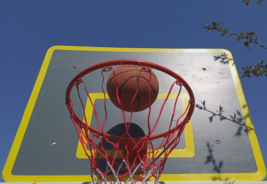The diy basketball backboard, gray with yellow lines, the hoop and the ball