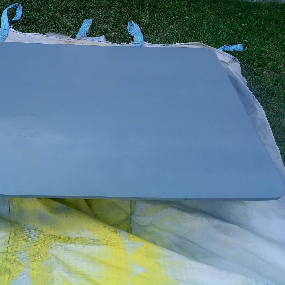 the first two layers of gray paint applied on the basketball backboard