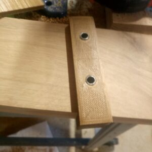 we positioned the printed jig for dowel joints on the face of the oak wood board