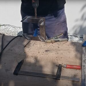 drilling two holes for the tightening screws we used
