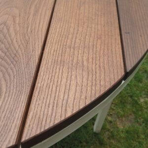 a detail with the finish of this round garden table