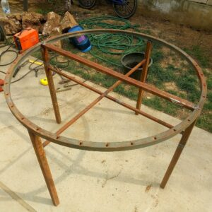 the metal frame of the round garden table is welded