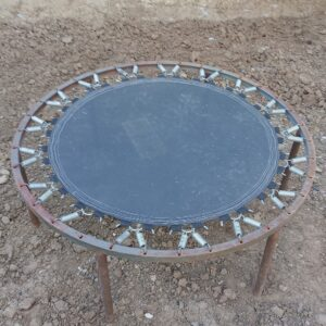 the kids trampoline is damaged, so we will use it to make a round garden table with thermally treated ash wood table top