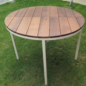 the garden table with round metal frame painted white and thermally treated ash wood table top