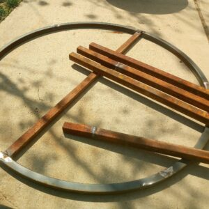 the round metal frames and the scrap pieces of square tubing needed to make the garden table