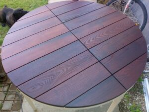 the thermally treated ash wood round table top is protected with oil