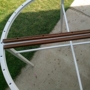 the narrow thermally treated ash wood planks are screwed into the square tubing welded in the middle of the round frame