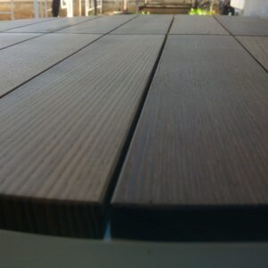 the round table top after applying a layer of oil