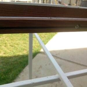 fixing the narrow planks into the pieces of square tubing welded in the middle of the metal frame