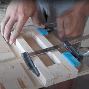 F clamps used to tighten the two wooden furniture pulls