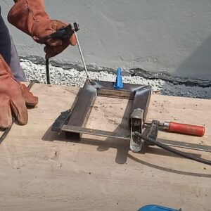 welding the corners of the c clamp for laminating wood boards