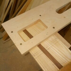 we fixed the plywood template on the ash wood board in order to route the inside of the tray